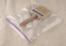 Staining: brush or pad applicator in a plastic bag for storage